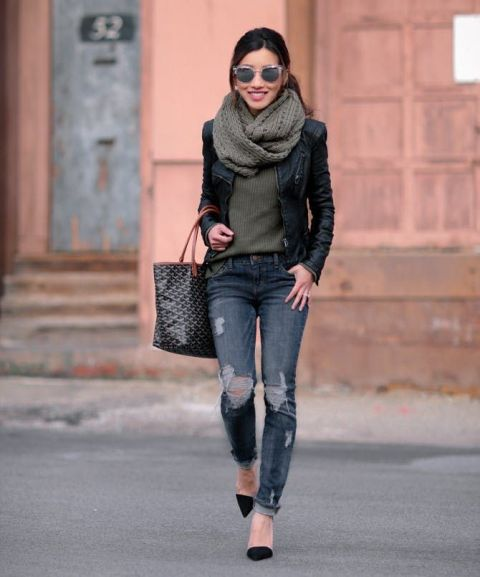 With olive green shirt, black jacket, distressed jeans, black pumps and tote
