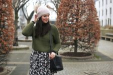 With olive green sweater, floral skirt and black bag
