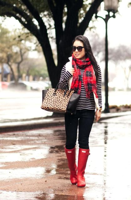 With plaid scarf, leopard tote, black pants and red boots