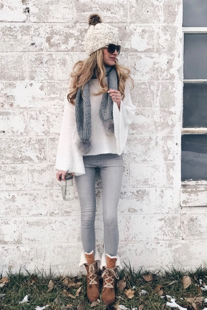 With pom pom hat, loose shirt, gray pants and lace up boots