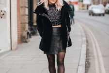 With printed shirt, black leather skirt and metallic boots