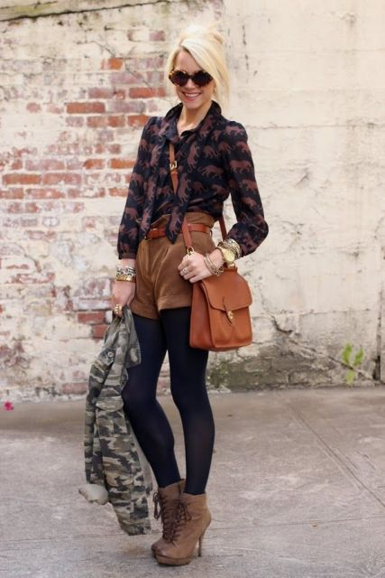 With printed shirt, crossbody bag, brown belt, black tights, lace up boots and sunglasses