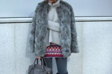 With printed skirt, gray tights, beige sweater, gray bag, over the knee boots and wide brim hat