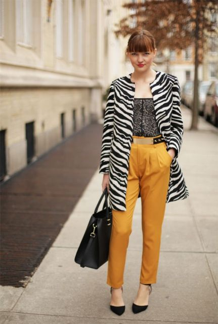 With printed top, yellow trousers, black tote and black shoes
