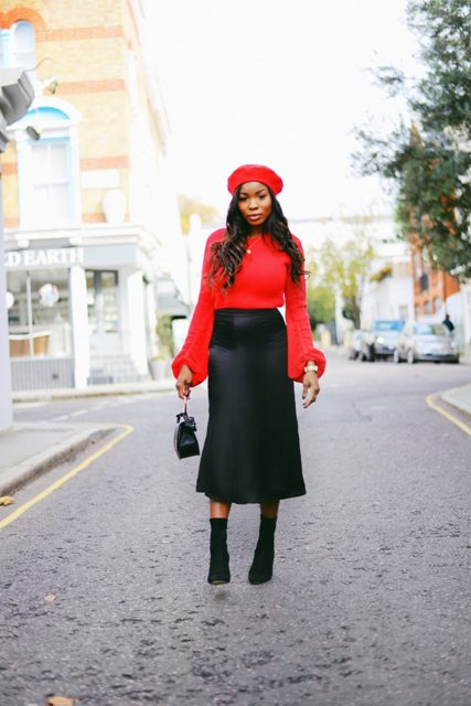 With red blouse, midi skirt, black small bag and black suede boots
