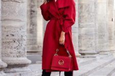With red coat, black pants, red bag and high heels