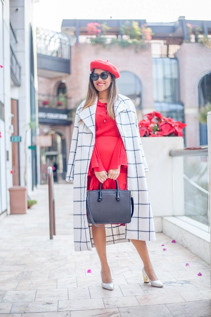 With red dress, printed midi coat, black tote and white shoes