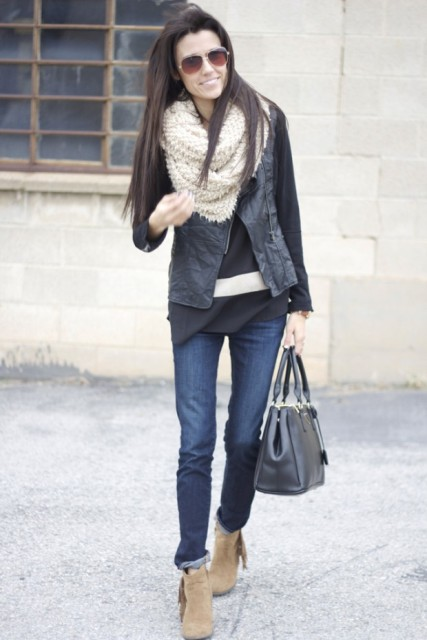 With shirt, black jacket, black bag, jeans and fringe boots