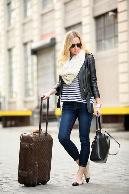 With striped shirt, black leather jacket, skinny crop jeans, two colored flats and white scarf