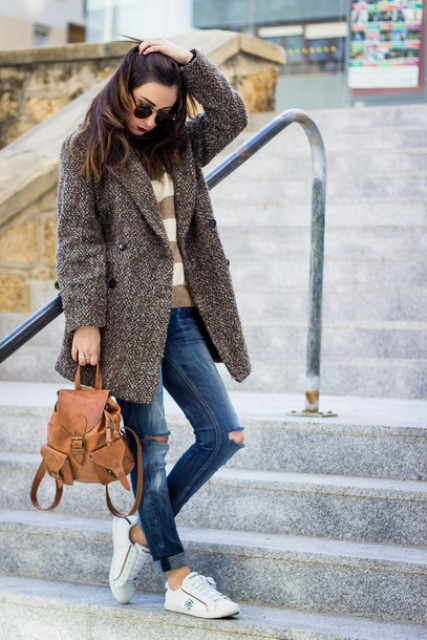 With striped sweater, coat, distressed jeans and white sneakers