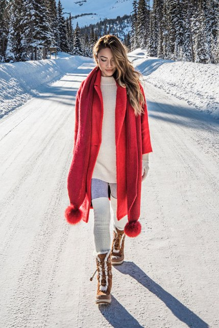 With sweater dress and lace up boots