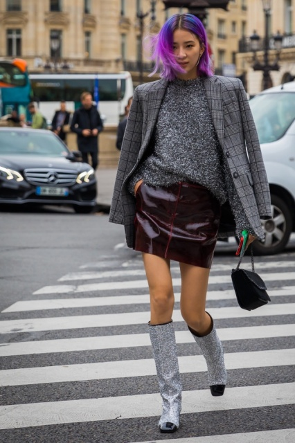 With sweater, leather skirt, black bag and plaid blazer