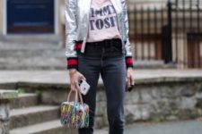 With t-shirt, flare jeans, black leather boots and printed bag