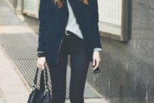 With t-shirt, navy blue jacket, hat, skinny pants and flat boots