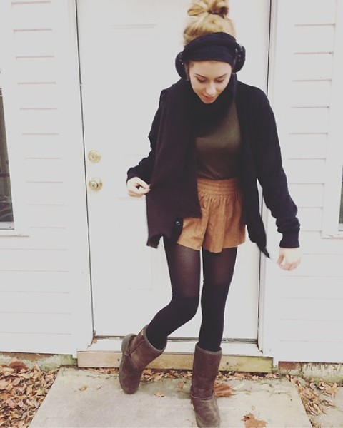 With turtleneck, high boots and black loose cardigan