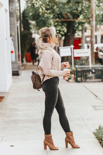 With turtleneck sweater, skinny pants and brown ankle boots