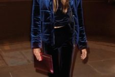 With velvet top, velvet trousers, navy blue pumps and marsala clutch