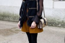 With vest, black tights, blouse, small bag and embellished shoes