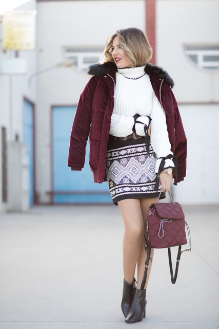 With white and black sweater, printed mini skirt, marsala puffer jacket and ankle boots