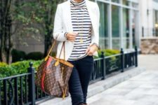 With white blazer, pants, brown high boots and printed tote