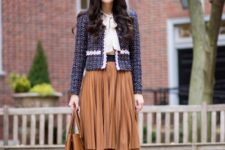 With white blouse, brown pleated skirt, navy blue shoes and brown bag