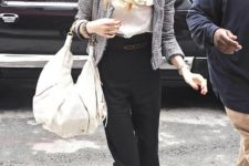 With white blouse, jacket, black high-waisted trousers and cutout shoes