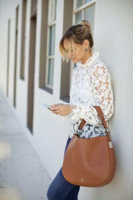 With white lace blouse and jeans