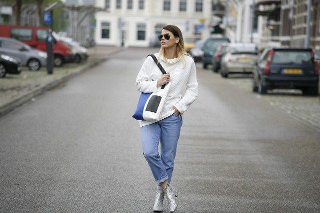 With white loose sweater, jeans and tote