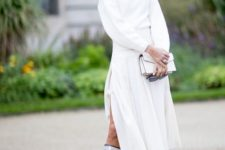 With white midi dress and white clutch