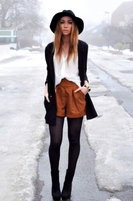 With white shirt, black cardigan, black hat, black tights and black ankle boots