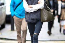 With white shirt, fur vest, leather tote, distressed jeans and black shoes