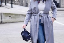 With white shirt, printed scarf, maxi coat, jeans and flat shoes