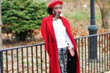 With white shirt, red coat, red leather boots and embellished trousers