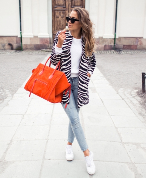 With white shirt, red tote, white sneakers and light blue pants