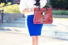 With white sweater, blue mini skirt and pumps