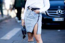 With white sweatshirt, black belt, mini bag and denim skirt