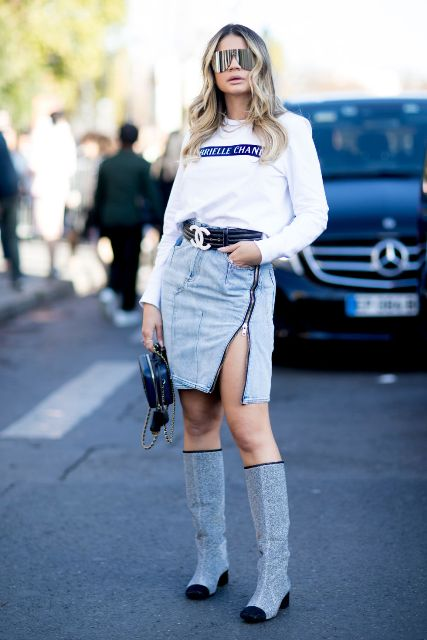 With white sweatshirt, black belt, mini bag and denim skirt