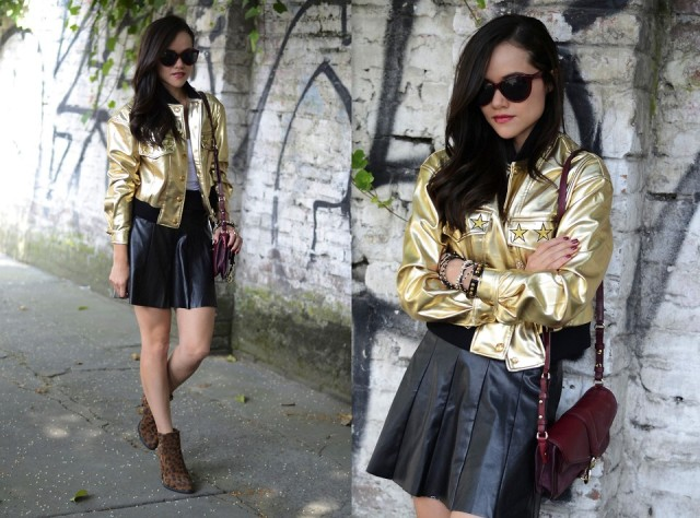 With white t-shirt, black leather skater skirt, marsala bag and animal printed boots