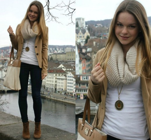 With white t-shirt, black pants, brown suede boots, tote and camel jacket