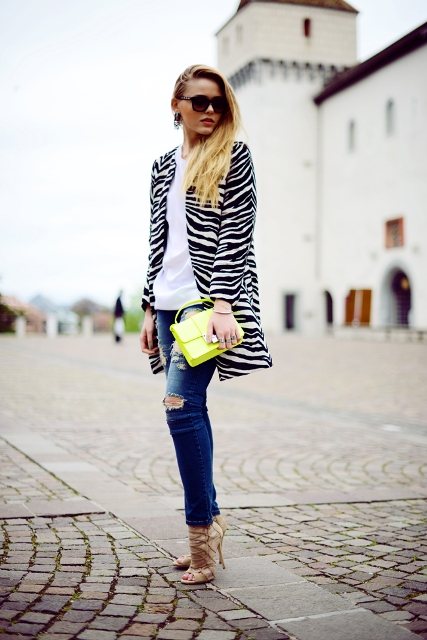 With white t-shirt, distressed jeans, high heels and yellow bag