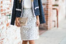 With white top, lace skirt, beige clutch and beige pumps