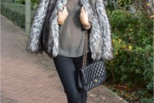 With wide brim hat, gray shirt, black trousers, flat shoes and leather bag