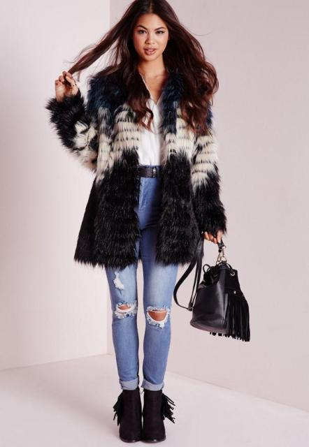 With wrapped blouse, distressed jeans, black belt, black leather bag and fringe boots