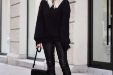 a black chunky knit sweater, black cropped pants, plaid slipns and a black bag