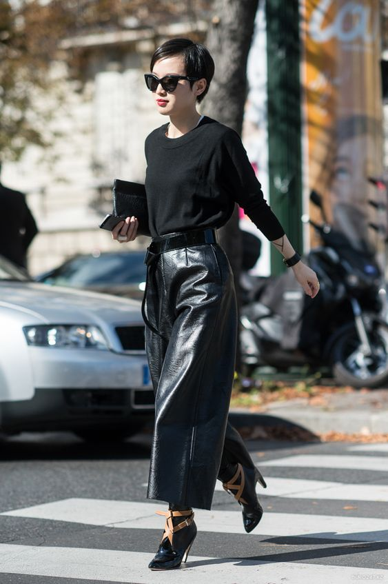 a black jumper, navy cropped leather culottes, black booties and a clutch for a minimalist look