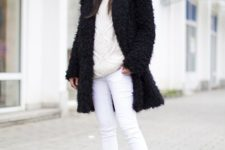 a creamy oversized sweater, white skinies, black fur winter boots and a black teddy coat