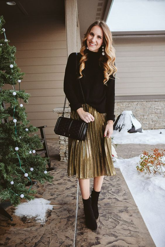 a festive look with a black oversized sweater, a metallic pleated skirt, black sock boots and a black bag