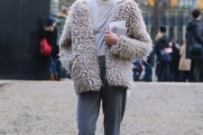 a grey top, grey sport pants, white sneakers and a neutral chunky teddy coat for a comfy look