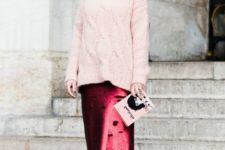a light pink cable knit sweater, a ripped burgundy midi skirt, white sneakers for a non-typical winter look