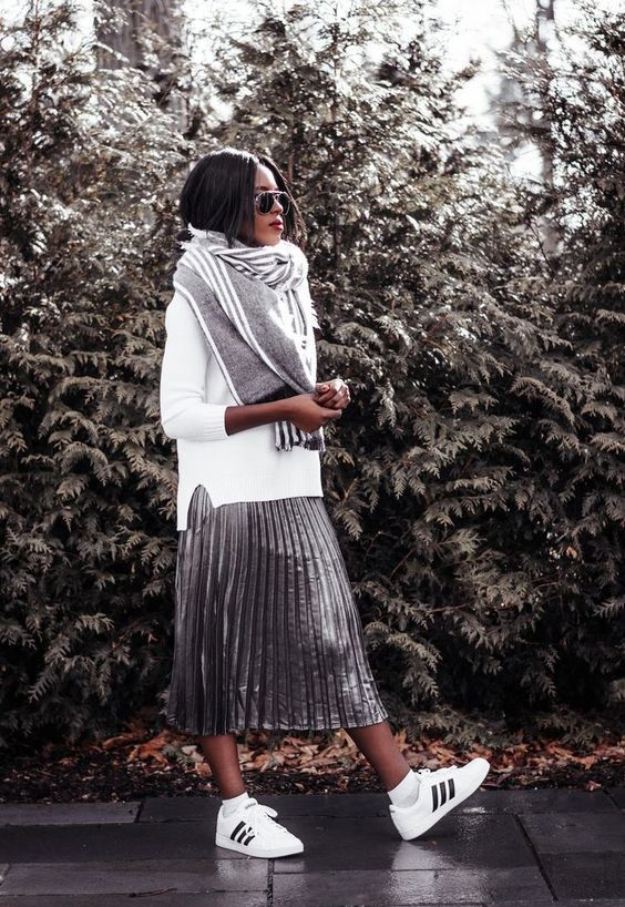 a metallic pleated skirt, a white sweater, a large grey scarf, white sneakers for a comfortable look